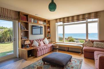 The comfortable sitting-room with great sea views.