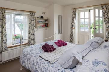 The double bedroom is gorgeous, a wonderful comfortable bed, a Juliet balcony and views right across the rooftops and the countryside beyond.