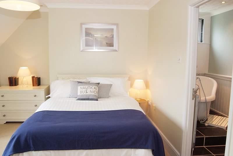The spacious master bedroom with en suite slipper bath.