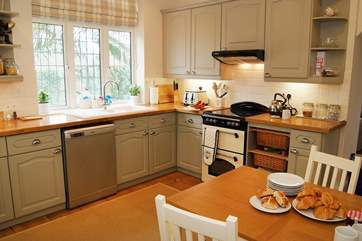 The kitchen next door is not only spacious but very well-equipped.