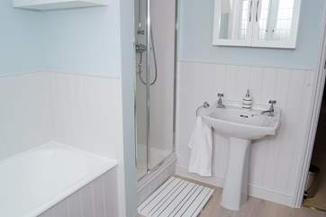 With both a bath and shower cubicle.