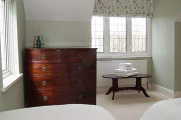 Antique furniture and calm colours with double aspect windows.