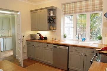 The stylish kitchen overlooks the garden and when the barbecue is ready you can exit left through to the back door.