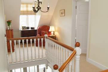 The large open landing with doors leading to all bedrooms and a cosy corner to take a moment or two.