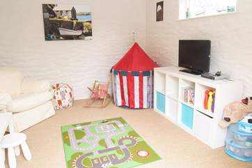 The playroom outside has lots of fun things to do for the young ones.