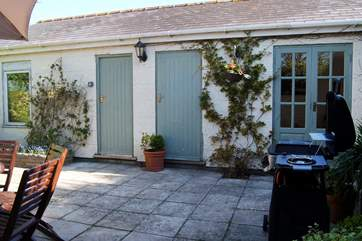 The playroom (the door on the right) can be found in the courtyard to the rear of the house.