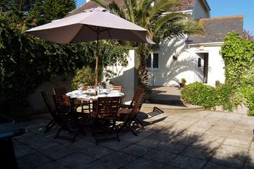 The outside space includes a large sheltered patio-area with barbecue for alfresco dining and with the gardens surrounding the house, there is space for everyone.