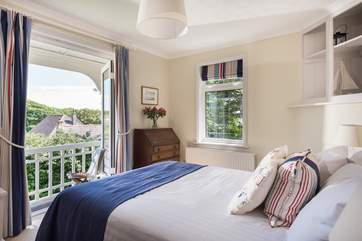 Bedroom 3 is equipped with a 4'6'' double bed and has its own balcony overlooking the garden.