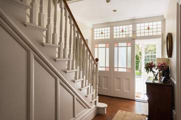 This fabulous house retains many original features including the gorgeous glass entrance porch.