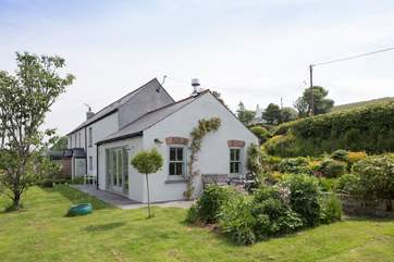 The cottage is surrounded by a lovingly maintained garden.