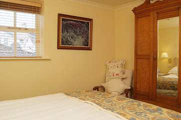 The cottage is furnished with quality antique furnishings.