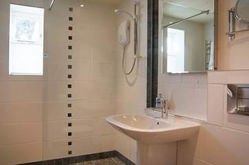 The wet-room has a large walk-in shower.