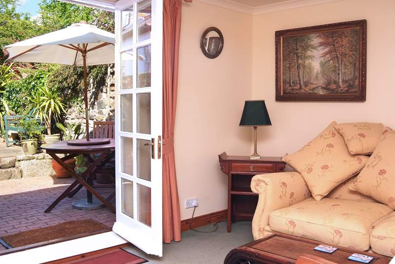 French doors open onto the sunny enclosed terrace.