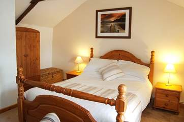 The lovely double bedroom is a spacious and relaxing space.