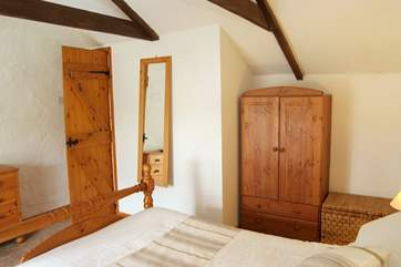 The double bedroom is traditionally decorated and furnished.