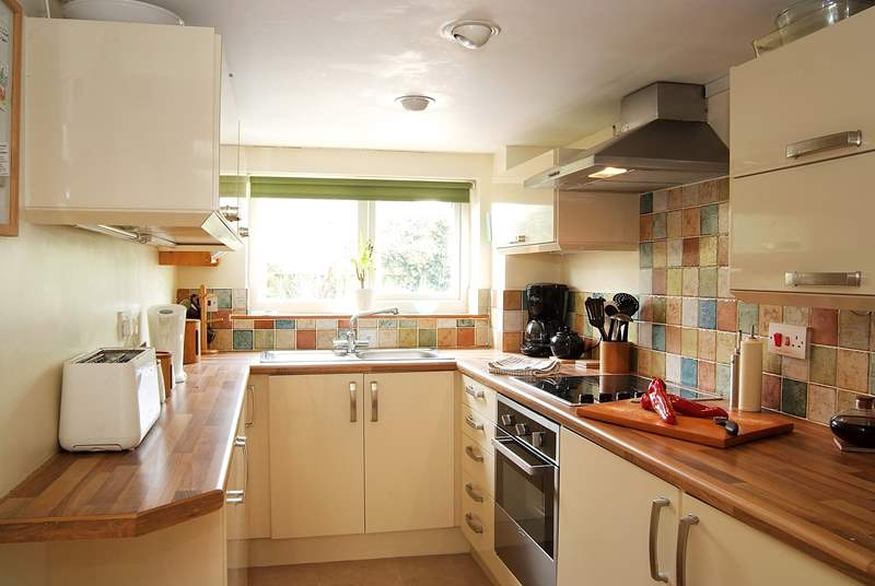 The kitchen is very well-equipped and surprisingly spacious.