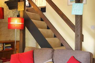 The traditional cottage staircase is a little steep with a low lintel on the way up and divides at the top step to the bedrooms.