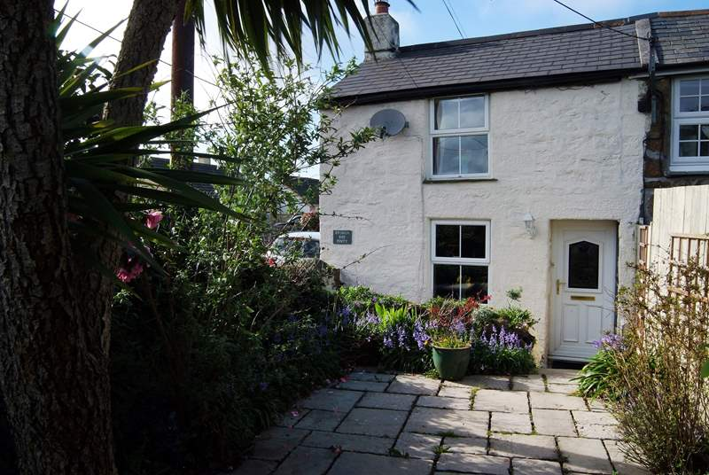 Located in the heart of this bustling village, the name of this lovely cottage translates to Little Rose Cottage.