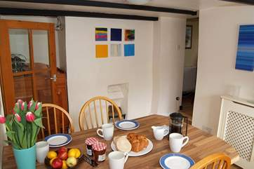 The dining-room links the sitting-room with the kitchen and rear patio garden.