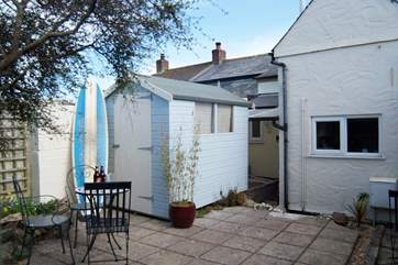 The rear courtyard is a real sun-trap, the perfect spot to relax after a day on the beach and with parking on the road alongside the cottage, it's not far to carry the surf boards.