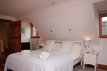 The master bedroom has an en suite shower-room.