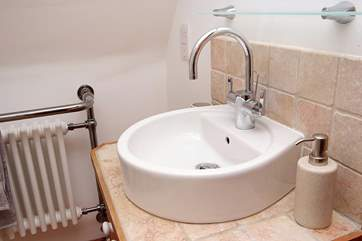 Modern fittings in the en suite shower-room.