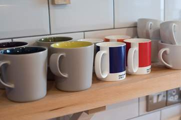 Colourful mugs in the kitchen.
