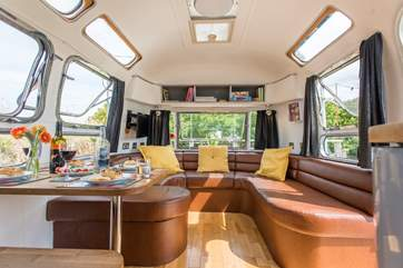 The comfy sitting-area, complete with TV, is at one end of the Airstream.