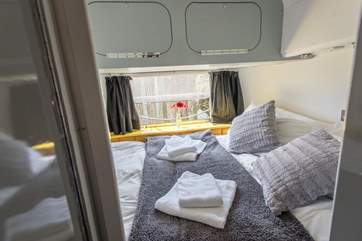 The comfortable double bed is just past the bunk-beds and has a door to close it off from the rest of the Airstream.