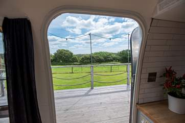 The countryside view can be enjoyed from inside or out.