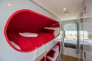 Kids will adore the pod-like bunk-beds.