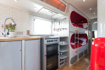 The kitchen includes an electric cooker - ideal for rustling up a scumptious supper.