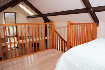 The mezzanine level bedroom has plenty of room for a child's bed and a cot.