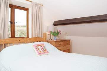 The bedroom on the mezzanine level, is spacious and comfortable (the bed has been replaced by a king-sized sleigh bed, a new photo will be taken soon)