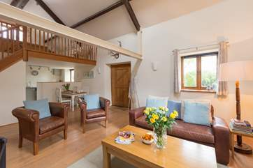The open plan interior of Headford Farm Cottage is bright and spacious. There is a little fully enclosed courtyard at the back and a lovely grassy paddock for your dogs to enjoy or for you to sit with