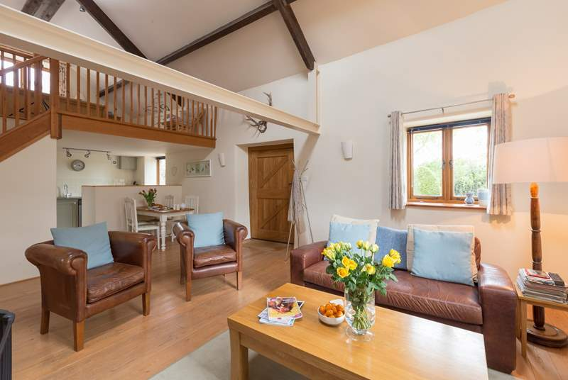 The open plan interior of Headford Farm Cottage is bright and spacious. There is a little fully enclosed courtyard at the back and a lovely grassy paddock for your dogs to enjoy or for you to sit and