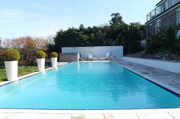 The heated 15 metre pool (available from the beginning of May to the end of September) with the hot tub at the far end.