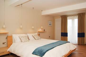 Bedroom 2 on the lower ground floor is very spacious and has a 6' double bed and doors out to the terrace.