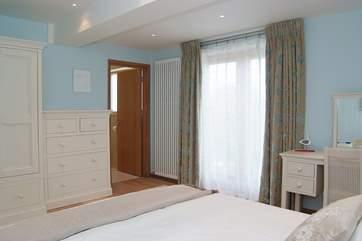 Bedroom 3 has an en suite bathroom.