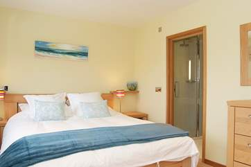 Bedroom 1 has an en suite bathroom with both bath and double shower cubicle.