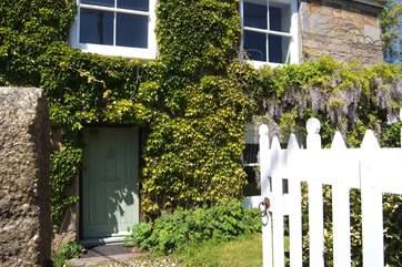 Open the gate, through the front garden and enter Montaza.