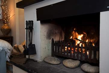 Relax by the roaring open fire.