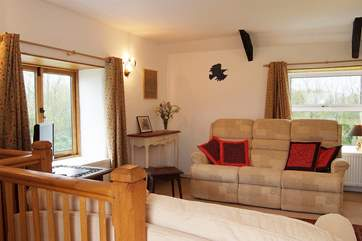 The upstairs sitting-room is comfortably furnished.
