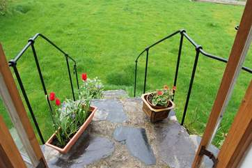 The steps from the sitting-room have a bespoke cast iron handrail made by a local craftsman.