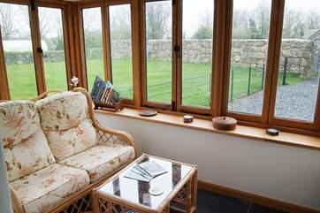 The oak-framed conservatory has great garden views.