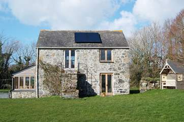 Pretty Chough Cottage is detached and surrounded by gardens.