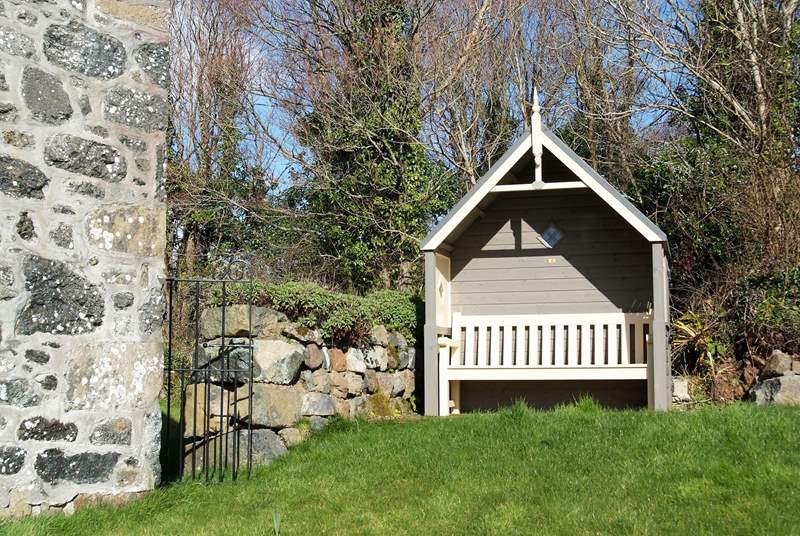 The wooden arbour is the perfect place to sit and read a book or simply take in the nature around you.
