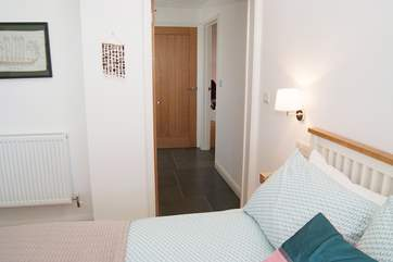 The bedroom leads to the hallway (with handy utility-cupboard) and right into the living-room.