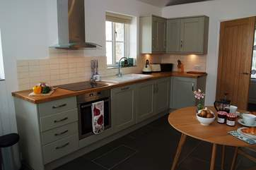 The well-equipped and very good looking kitchen.
