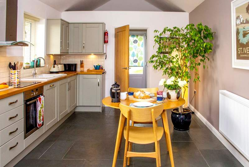 Stylish, light and well equipped kitchen.